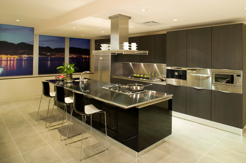 A green kitchen from top to bottom cabinets to floors